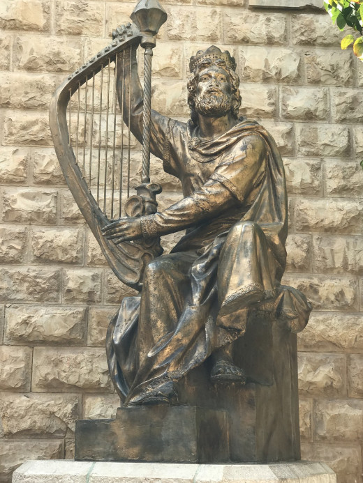 People create artforms to remember the kings they thought were good kings, like this statue of King David.
