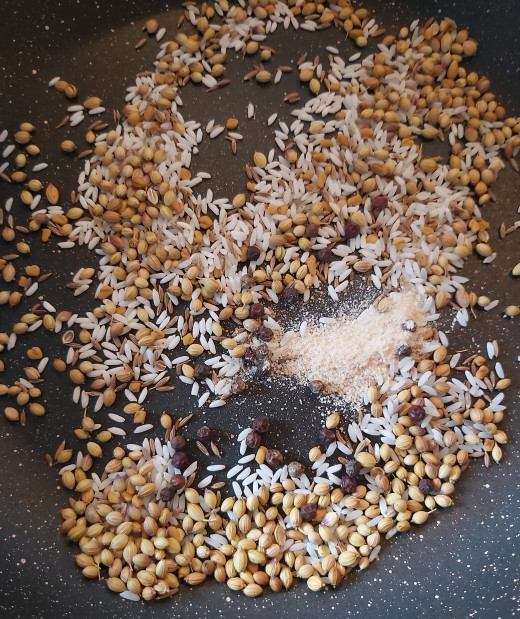 Add 1/2 teaspoon of whole black pepper (or more if you want more spicy sambar) and 1/4 teaspoon of hing or asafoetida.