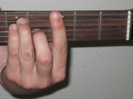 Me making a G Bar Chord on the guitar.