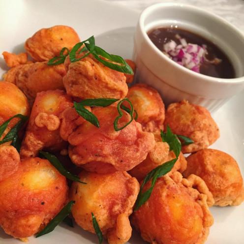 Kwek-kwek with vinegar dipping sauce