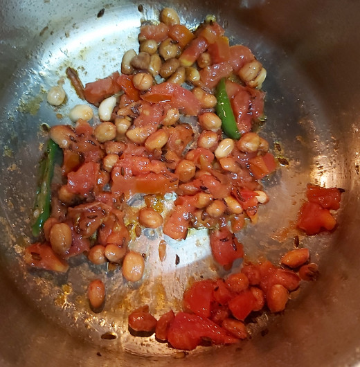 Add chopped tomatoes and fry till cooked well.