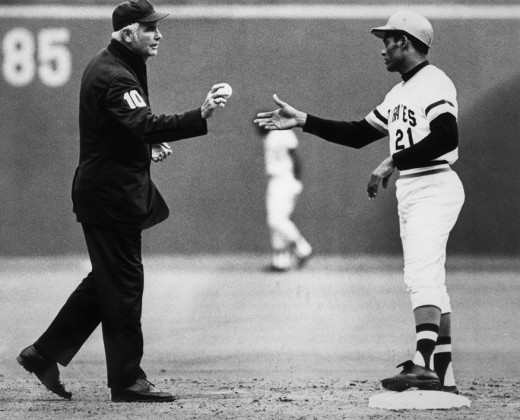 Roberto Clemente being handed his 3000th hit in 1972, the last of his career.