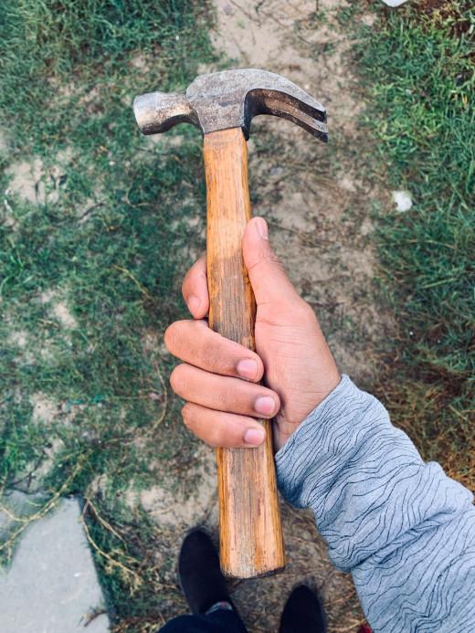 A carpenter using his hammer.