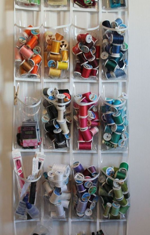 Why not use an sheer shoe organizer behind a door to organize your thread collection?