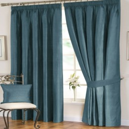 100% pure silk curtains in teal add elegance and flair