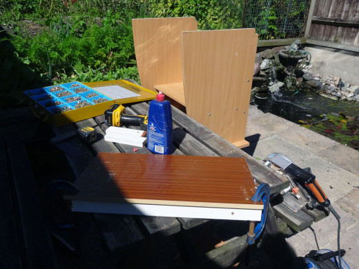 Gluing and screwing the kickboard to the base shelf.