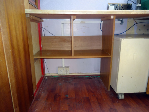 Bespoke shelving unit, showing the space left behind and above the backstop for cable management.