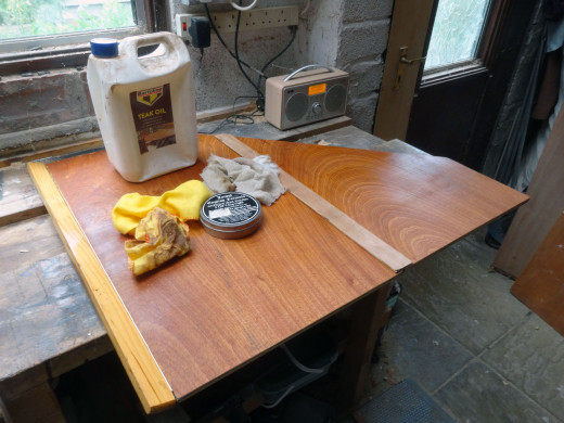 After wiping clean with white spirit to remove sawdust, using teak oil and coloured beeswax to enrichen the colour and shine of the natural wood.