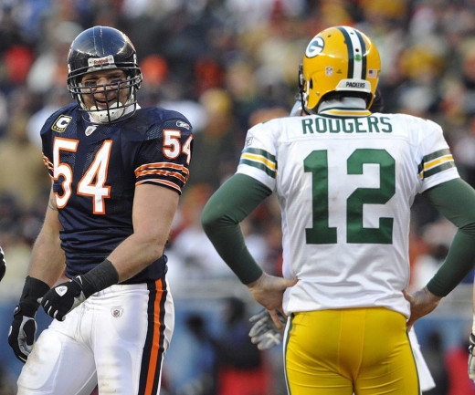 Brian Urlacher (left) talking with Aaron Rodgers (right).