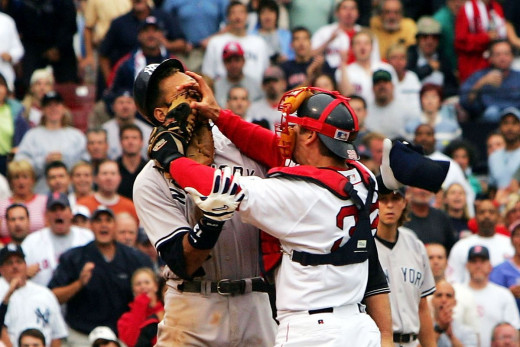 Jason Varitek (right) fighting with Alex Rodriguez (left).