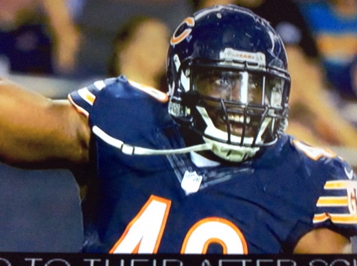 Former Chicago Bears Sam Ocho was one of the athletes who donated money to bring the first fresh grocery market to a black neighborhood in Chicago. He worked with students who run the store.