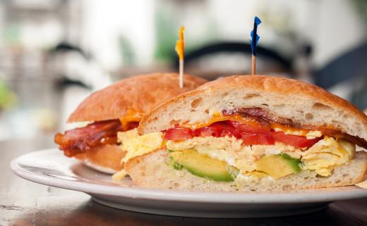 Bacon, egg, cheese, tomato and avocado sandwich.