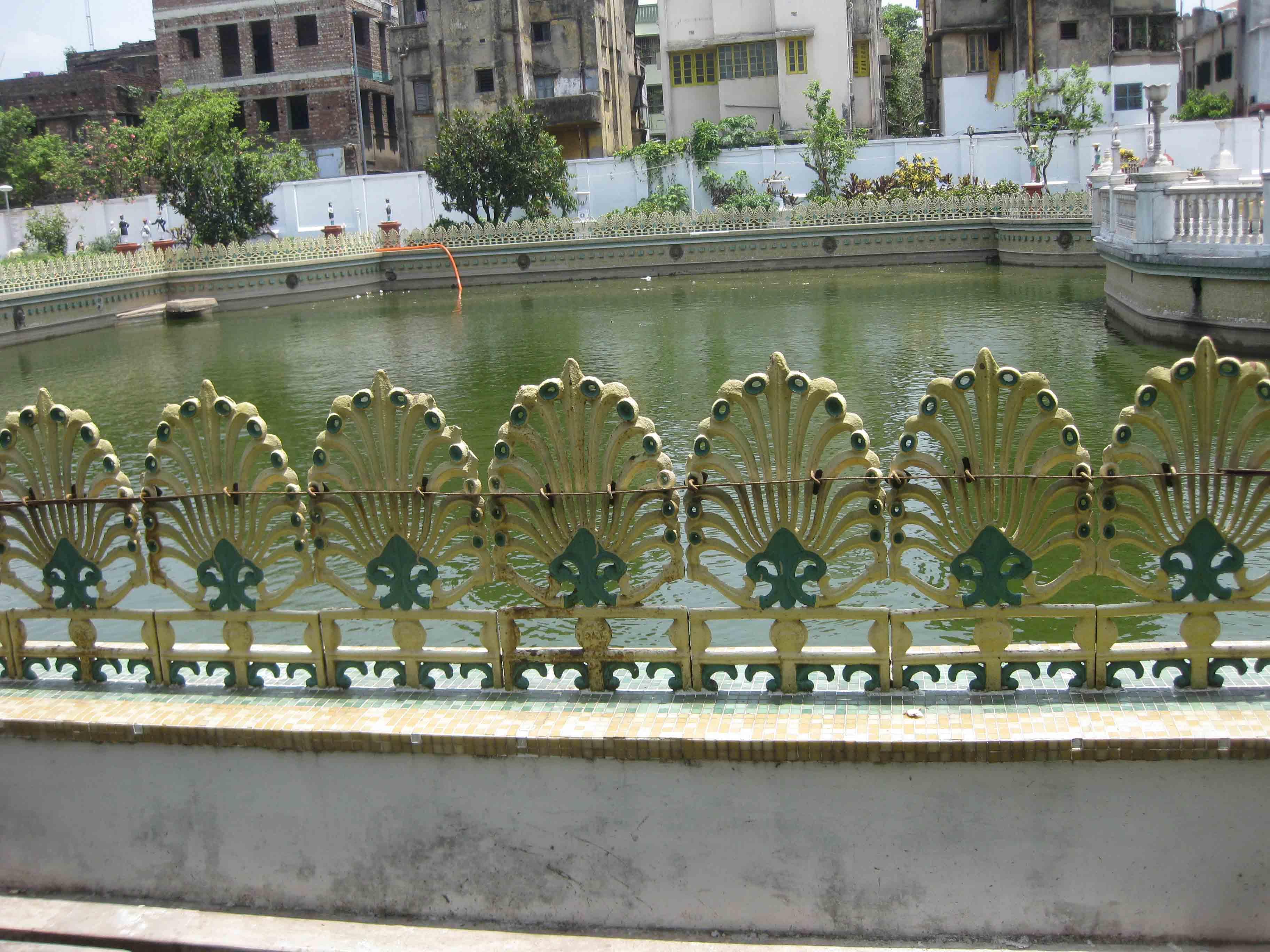 Cast iron railing surrounding the pond