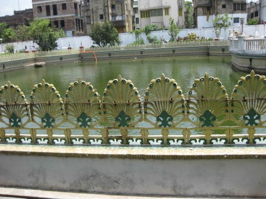 Cast iron railing surrounding the pond