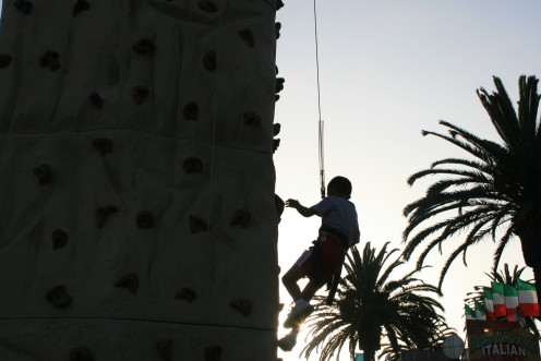 This young boy made it all the way to the top of the climbing wall, notice the palm tree in the background! (see below for some action shots!)