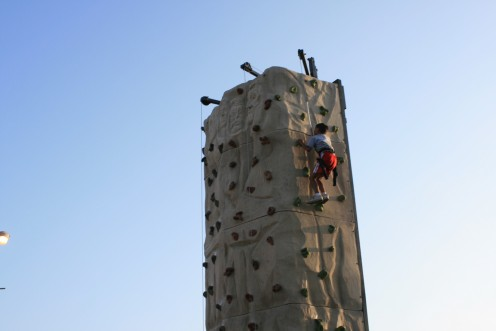 Eight year old boy, harnessed securely, made it to the very top of the Rock Climbing wall!