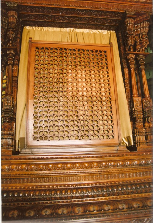 Exquisite wooden screen and window frame at the temple( such wood craftsman are amply available in karnataka)
