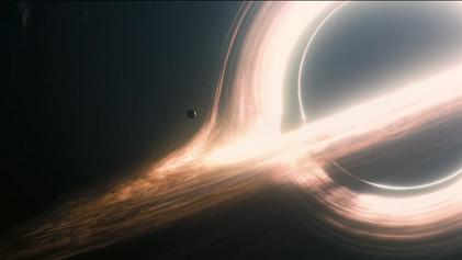 Scene of Miller's planet orbiting a large black hole named Gargantua.