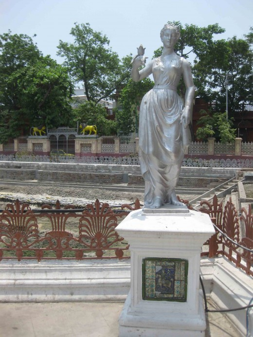 Woman with a flower-Woman in style-Teracota statue in Parasnath Jain temple, Kolkata