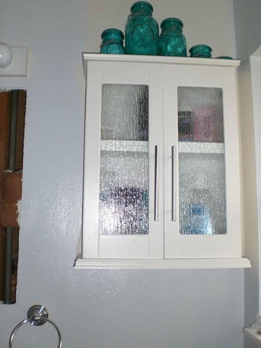 Bathroom kitchen and garage storage cabinets