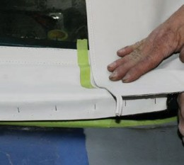 Alignment is vital. Here, the right quarter of the main top is OVER the rear window curtain before stapled.