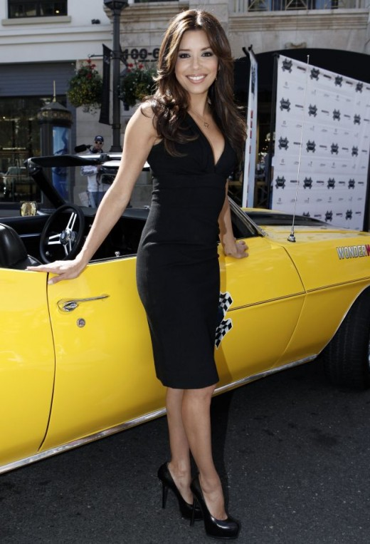 Eva Longoria in a little black dress and towering high heels at the rally for Cancer Kids in March 2009