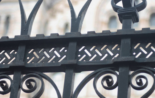 Ironwork or metal fences can be used to bring metal energy to outdoor spaces.