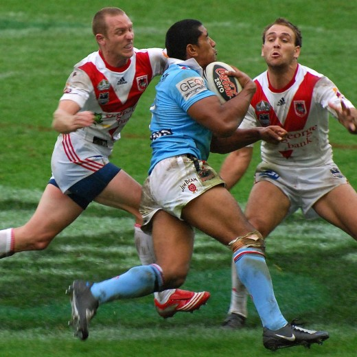Sydney Roosters centre Iosia Soliola about to take a two-man tackle.  CRUNCH!