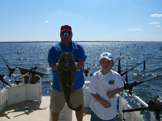 This is Stacy and Andrew with a really nice flathead they co-caught, he was a fighter!