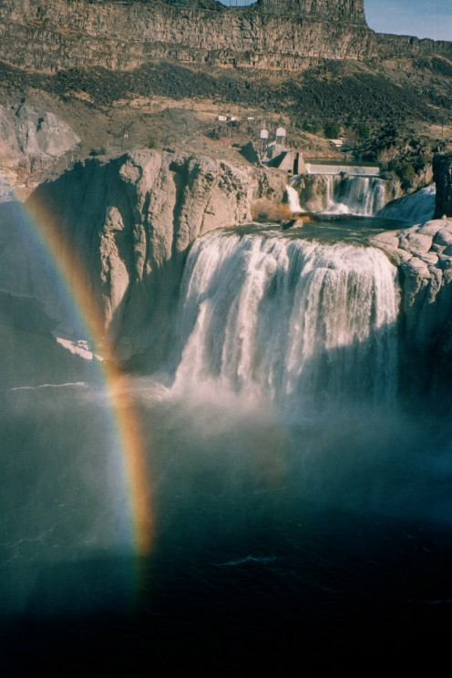 This is a rainbow caused by the mist or spray thrown up by the water crashing 212 feet down onto the rocks.