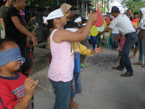 Children participated in balloon-popping contest.