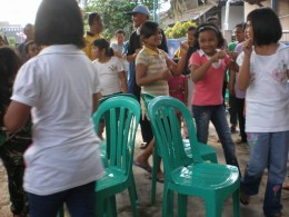 This one is a dance contest. The participants  competed for the chairs which is less in number than the participants .