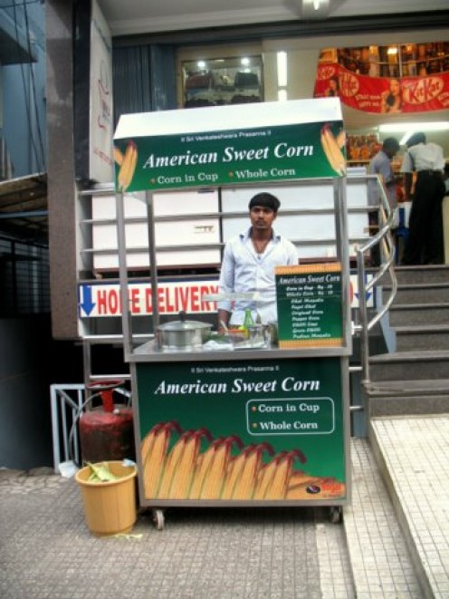 American hot Popcorn right on footpath in front of a Dept Store