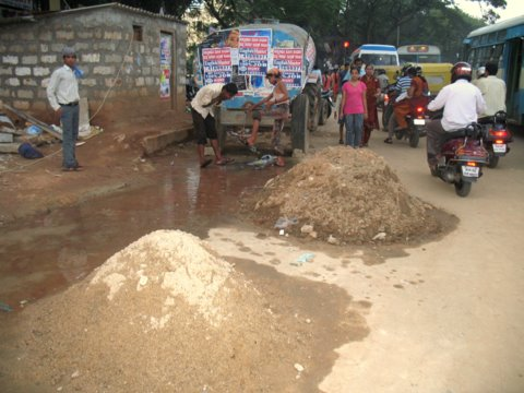 Water for wash right on road no drainage.