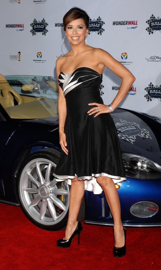 Eva Longoria in a dress and towering high heels