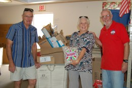 These folks are DeWayne, Peg and Tom.  DeWayne helps pack food boxes. Peg is pretty much in charge of what gets packed in the hygiene room and her husband, Tom, helps with that and whatever else needs doing.