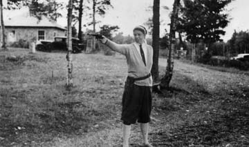 Eleanor Roosevelt in Knickers and shooting a pistol