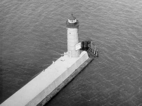 A lighthouse standing forward, on guard (public domain).