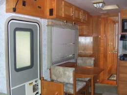 Inside view side door and dining area. Table expandable to fit 4.
