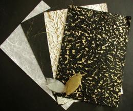 Handmade scrapbook paper adds texture to your design.