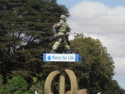 Why there is a statue of an askari with Water for Life, Lord alone knows
