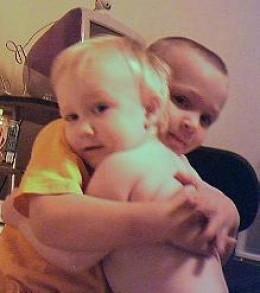 Travis & Marc Hug a few years ago.