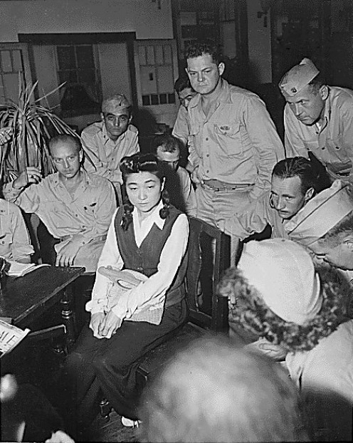 One person interviewed by many: Iva Ikuko Toguri D'Aquino known as Tokyo Rose during Interview . In a panel employment interview, the interviewers sit on one side of a table.