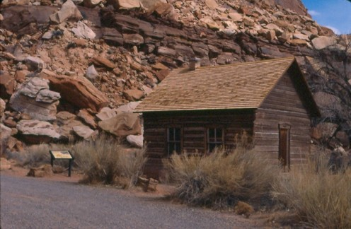 The Fruita School House is dwarfed by the massive sandstone boulders, Capitol Reef National Park, Utah.