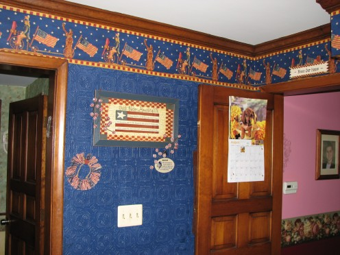 I put the paintable wallpaper and painted it with a bright, deep blue.  I have Americana items on the walls; the bottom knotty pine gives it a country feel