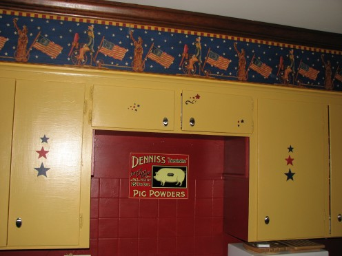 I stenciled star patterns on the golden cupboards to bring the Americana theme out