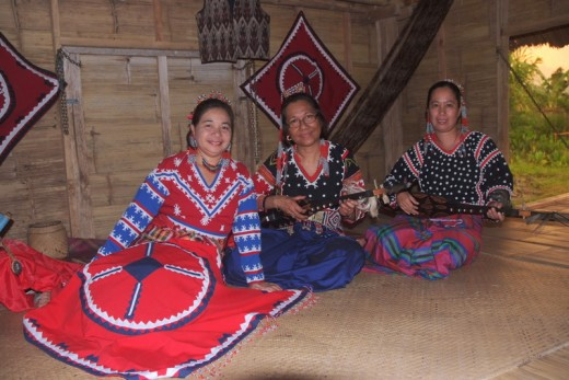 Musical instruments and traditional dress of T'boli women of Lake Sebu, Philippines.