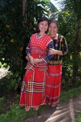 Daughter and mom wear their handwoven traditional T'boli dress in Lake Sebu, Mindanao.