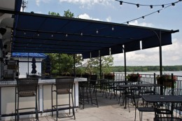 Outdoor patio canopies like these are great for outdoor bar and restauarants.  Photo by http://www.flickr.com/photos/shadetree_canopies/3792247773/in/photostream/