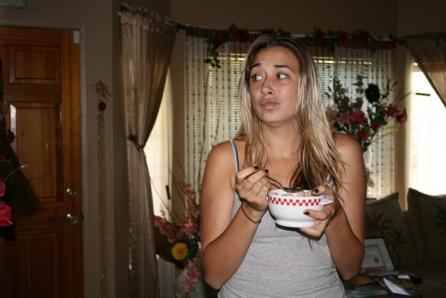 """Early morning, not a familiar time for Sara, she isn't really awake in this picture, she is eating """"automatically""""."""
